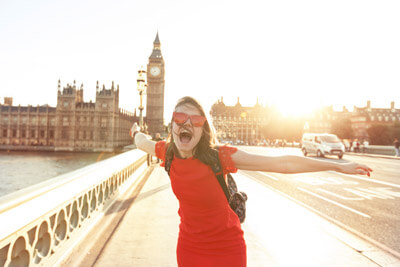 Woman having fun at sunset at Westminster bridge